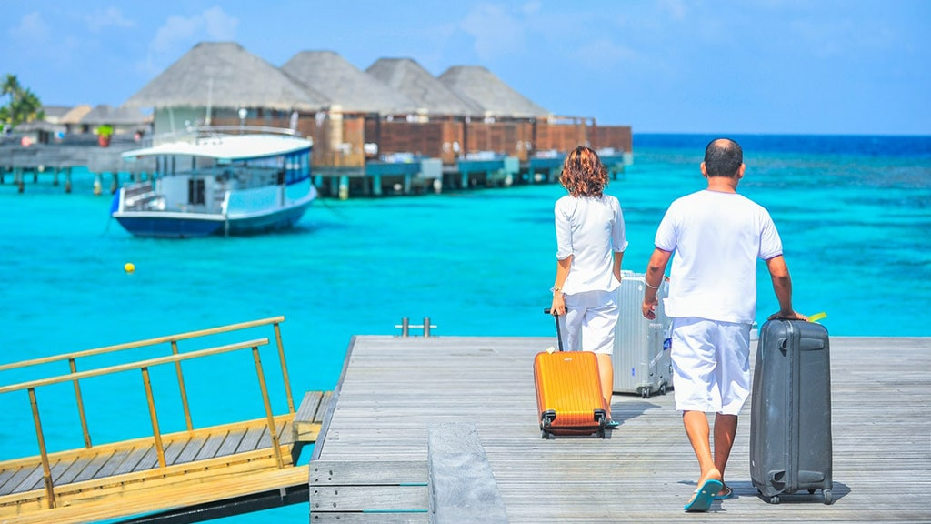 A couple travelling at a resort.