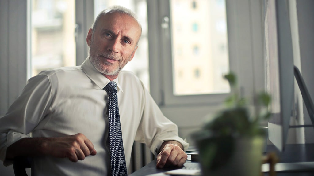 A business man has hair loss.
