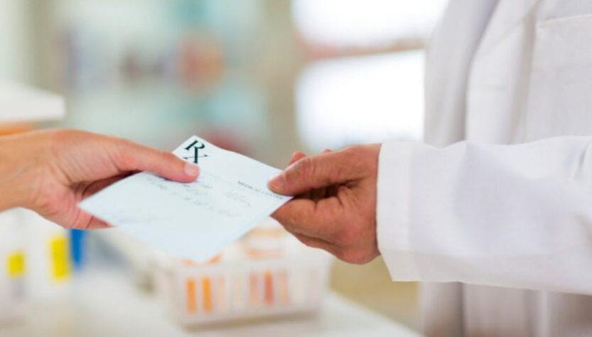 A doctor holding patient's prescription.
