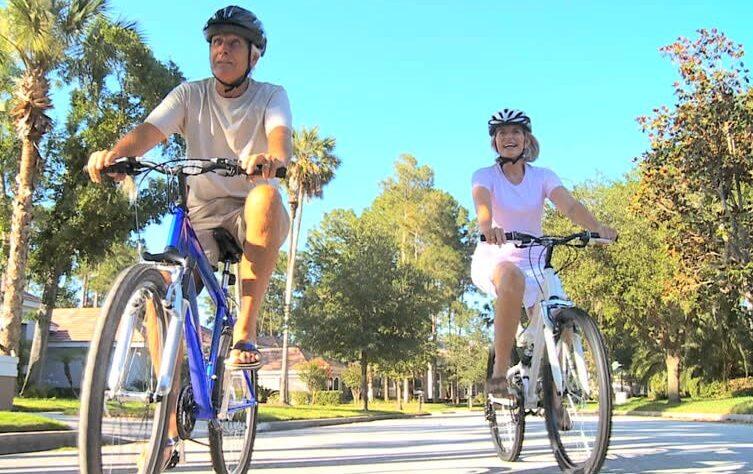 Two people driving bike.