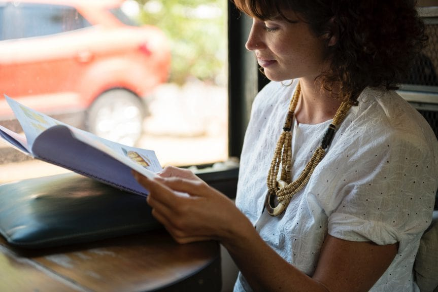 A woman reading a book.