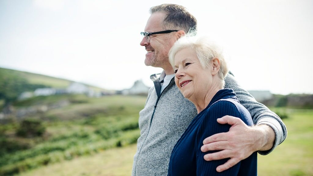 Erectile Dysfunction Category Image- A happy couple hugging each other on the hill