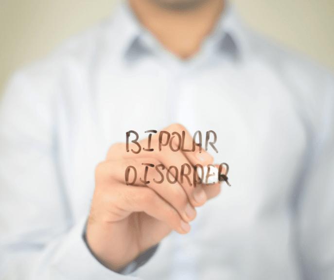 "A man writing ""Bipolar disorder"" word"