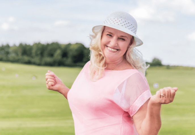 Menopause Medication Category Image- A smiling woman standing in big yard.