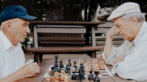 Two old people playing chess