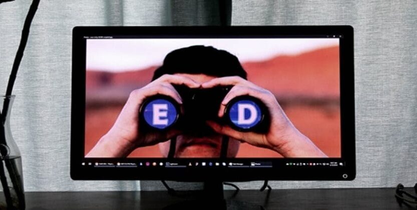 The screen has a man using binoculars with 'E', 'D' letter.